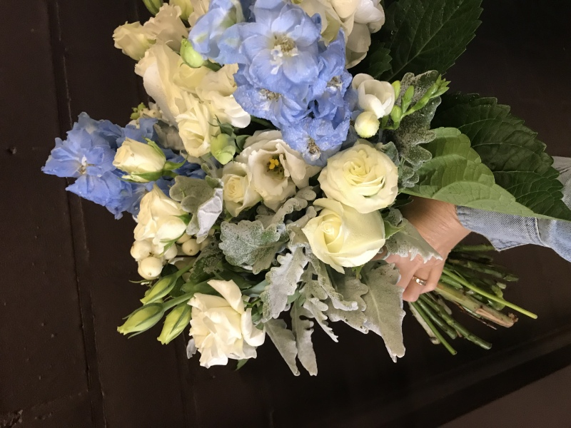 Hydrangea and soft blue delphinium, dusty miller, spray roses, lissianthus rustic bouquet