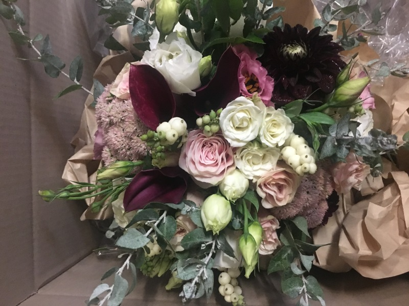 Calla lilly and dahlia bridal bouquet, burgandy and cream blooms native foliages and seasonal florals