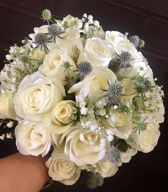 cream and white bridal bouquet scattered with dusty miller
