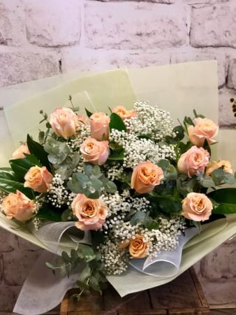 15 Coloured Roses with Babies Breath in a Bouquet
